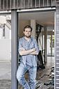 Mature man standing in door of his new home - JOSF00498