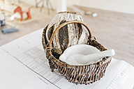 Bread and salt as traditional gift for moving in a new home on a construction plan - JOSF00537