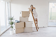 Mature businesswoman moving into her new home - JOSF00552