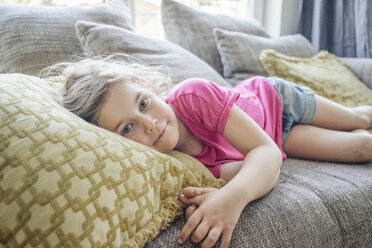 Portrait of girl lying on couch - JOSF00591