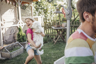 Girl playing with dog in garden - JOSF00594