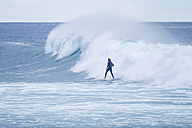Spain, Tenerife, Teenage boy surfing on sea - SIPF01398