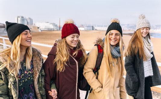 Four friends walking near the beach - MGOF02903