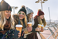 Four friends with coffee to go in winter - MGOF02945