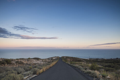 Spain, Tenerife, empty road at dusk - SIPF01402