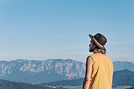 Austria, Mondsee, Mondseeberg, rear view of young man wearing a hat - WVF00834