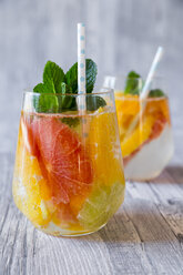 Two glasses of detox water infused with citrus fruits - SARF03182