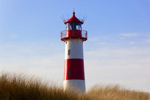 Germany, Sylt, red-white striped lighthouse - KLR00513