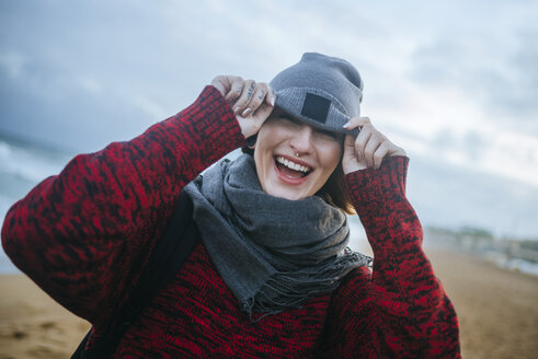 Happy young woman on the beach in winter - KIJF01185