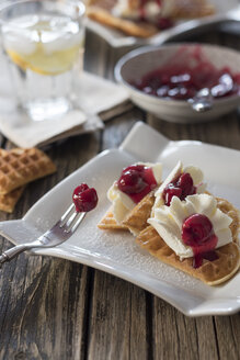 Plate of waffles with whipped cream, cherries and cherry groats - YFF00640