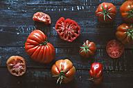 Oxheart tomatoes on black wood - RTBF00662