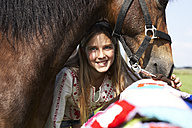Portrait of smiling girl with horse - FSF00789