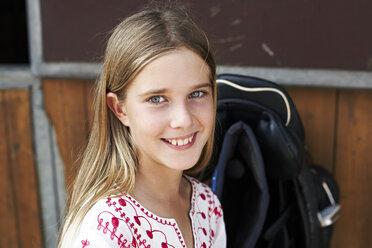 Portrait of smiling girl on horse farm - FSF00792