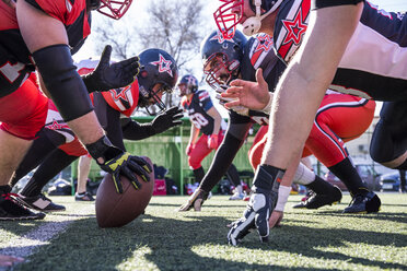American football players on the line of scrimmage during a match - ABZF01909
