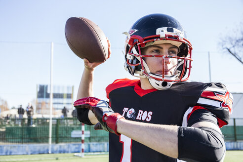 American football player throwing the ball during a match - ABZF01921