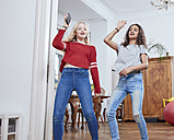 Two girls dancing at home - RHF01804