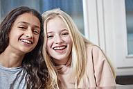 Portrait of two happy girls side by side - RHF01825