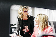 Two businesswomen working together in office - JRFF01195