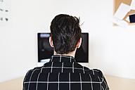 Man at home using computer - FMOF00163
