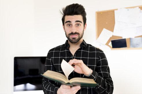 Portrait of man holding book - FMOF00175