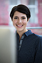 Portrait of smiling woman in office - FKF02163