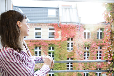 Woman looking out of window - FKF02175