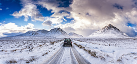 UK, Scotland, Glen Etive, Four wheel drive vehicle in winter - SMAF00672