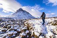 UK, Scotland, Glencoe, Buachaille Etive Mor, Female walker - SMAF00678
