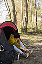 Young woman in tent in the nature - KKAF00405