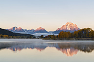 USA, Wyoming, Rocky Mountains, Teton Range, Grand Teton National Park, Snake River, Oxbow Bend, Mount Moran, Indian Summer, twilight - FOF08866