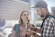 Young traveler couple applying sun cream - ZEF12824