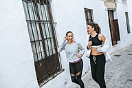 Young women jogging in the street - KIJF01231