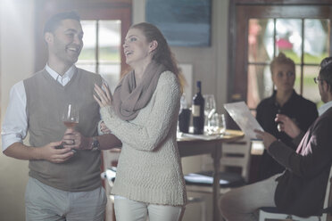 Happy couple with glass of wine - ZEF12860