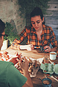Young couple painting animal figurines with paint - RTBF00677