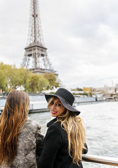 Paris, France, two tourists taking a cruise on Seine River with Eiffel Tower in the background - MGOF02982