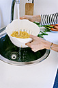 Young woman cooking pasta - VABF01173