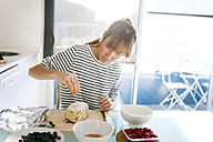 Young woman preparing vegan cake - VABF01191