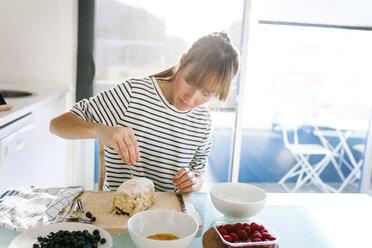 Young woman preparing vegan cake - VABF01191