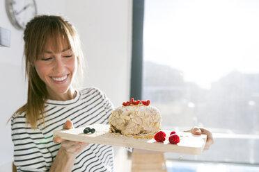Young woman presenting vegan cake - VABF01194