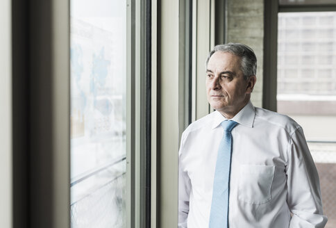 Portrait of a senior manager, looking out of window - UUF09926