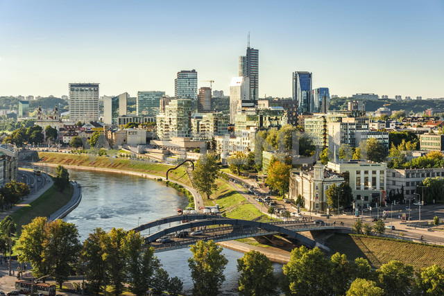 Lithuania, Vilnius, view to the modern city of Vilnius with Europa Tower and Neris River in the foreground - CSTF01224