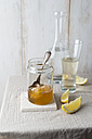 Honey jar with honeycomb and glass of water with honey - MYF01877