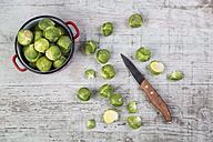 Brussels sprouts, kitchen knife and cooking pot - JUNF00849