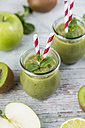 Gass of green smoothie and ingredients on wood - JUNF00858