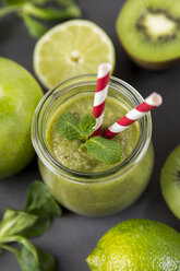 Glass of green smoothie and ingredients - JUNF00861
