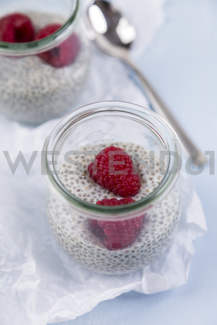 Glass of chia pudding with soya vanilla milk and raspberries - JUNF00870
