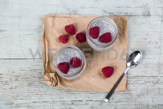 Glass of chia pudding with soya vanilla milk and raspberries - JUNF00873