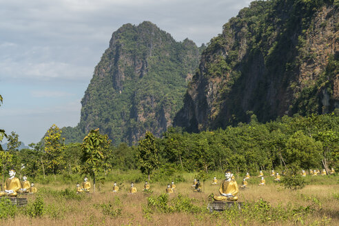 Myanmar, Hpa-an, Landscape with rock formations and field of Buddhas - PCF00340
