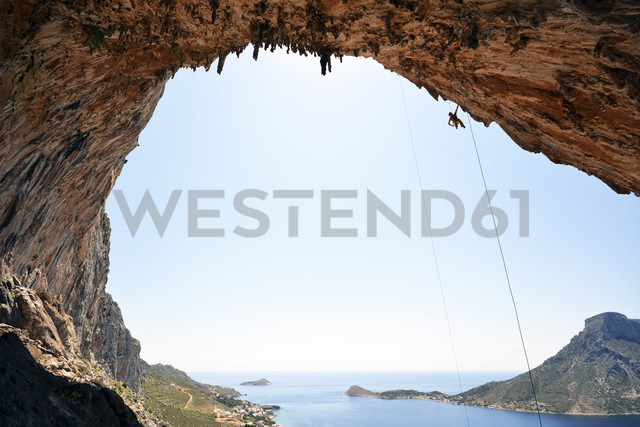 Greece, Kalymnos, climber abseiling in grotto - LMF00673