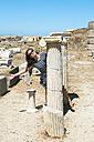 Greece, Mykonos, Delos, happy woman visiting archaeological site - GEMF01499